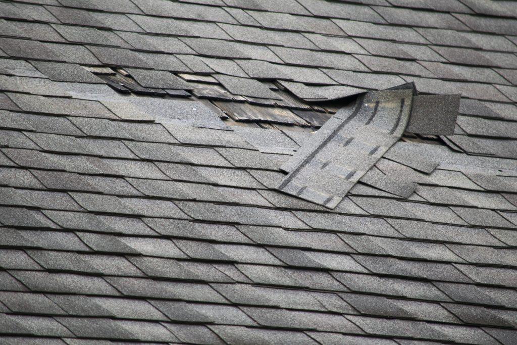 Asphalt Shingles Pealing Off Roof